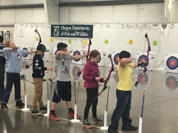 Students shooting arrows